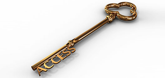 An old-fashioned gold key over a white background. The key spells 'access' on the serrated edge.