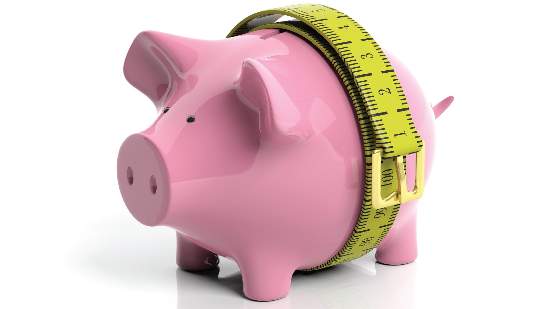 Piggy bank with a tape measure tightened around its belly.