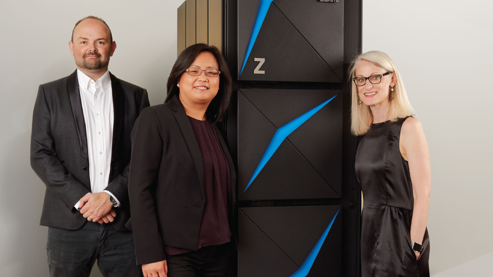 IBM Z Offering Manager Matt Whitbourne, IBM Z Product Manager Miao Zhang-Cohen and IBM Z Design Lead Kirsten McDonald pose with the new z15.