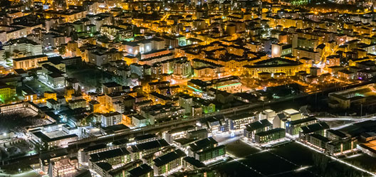 A photograph of a city at night from above.