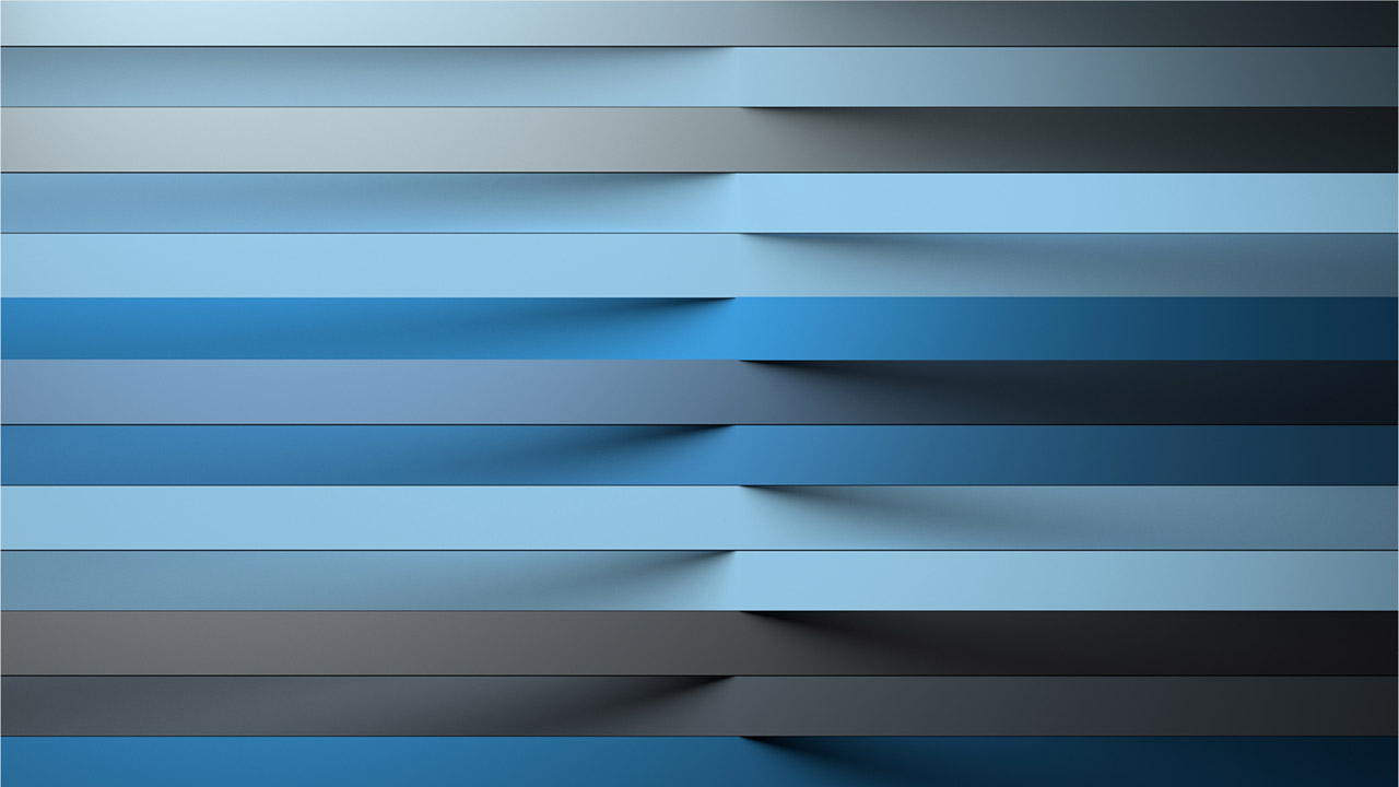 Different strips of blue paper of various shades in a row.