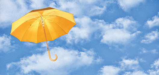 A yellow umbrella against a blue sky.
